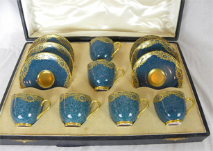 A Set Of Six Boxed Royal Worcester Dark Blue Gilded World War One Cups And Saucers